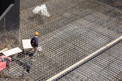 Workers make reinforcement for concrete foundation Royalty Free Stock Photos