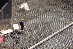 Workers make reinforcement for concrete foundation Stock Images