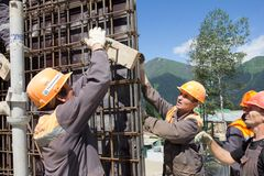 Workers make reinforcement for concrete wall Stock Photo
