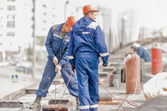 Workers make waterproofing of seams on the bridge Stock Photography