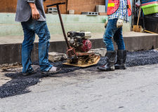 Workers making asphalt road Royalty Free Stock Images