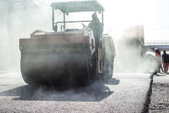 Workers making asphalt with shovels at road Royalty Free Stock Images