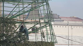 Workers making construction for new year pine celebrate stock footage