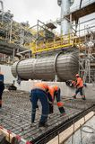 Workers making foundation in chemical factory stock photos