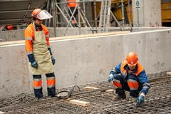 Workers making foundation in chemical factory royalty free stock photo