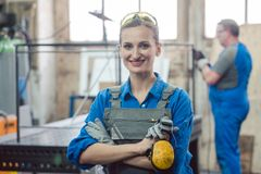 Workers in a metal workshop Stock Photography