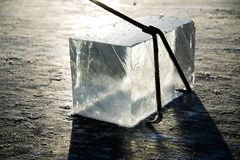Workers mine large cubes of natural river ice, harvesting river ice stock photography