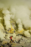 Workers mining sulfur inside volcano Ijen royalty free stock image