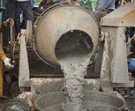 Workers mixing cement Royalty Free Stock Image