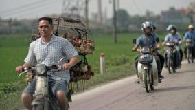 Workers on motorbikes, Hanoi, Vietnam Royalty Free Stock Photography