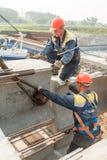Workers mouning bridge span Royalty Free Stock Photo