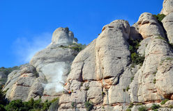 Workers on the mountain at Monserrat, Catalonia, Spain Stock Photo