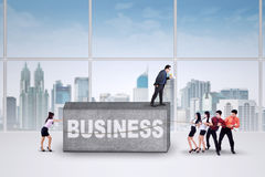 Workers moving a business burden Stock Photo