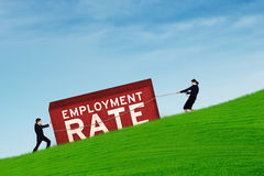 Workers moving an employment rate text Royalty Free Stock Photography
