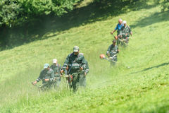 Workers Mowing The Grass In Springtime In Youths Public Park Royalty Free Stock Photo