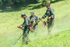 Workers Mowing The Grass In Springtime In Youths Public Park Stock Image