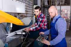 Workers near milling machine Stock Image