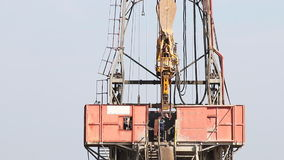 Workers on oil drilling rig stock video