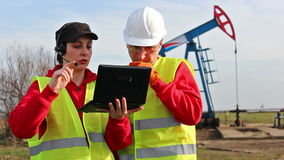 Workers in the oil field stock footage