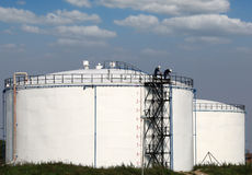 Workers on oil tank Stock Photography
