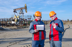 Workers in the oilfield talking on the radio Royalty Free Stock Image