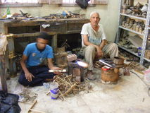 workers old Cairo making hand made pottery in fostat area cairo fokhareen area fostat mary gergis  concept and metaphor Royalty Free Stock Photo