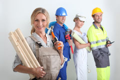 Workers with one in the foreground. Four workers with one in the foreground royalty free stock photo