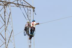 Free Workers Over A High Tension Tower Making Reparations. Stock Image - 103607371