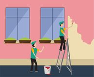 Workers paint the wall in pink Stock Images