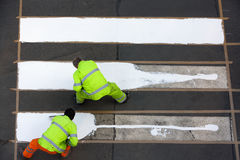Workers painting crosswalk Royalty Free Stock Image