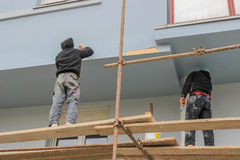 Workers painting and repairing facade Royalty Free Stock Photography