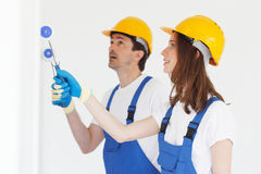 Workers painting wall Royalty Free Stock Photo
