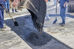 Workers patching asphalt during road repairing works 2 Stock Photography