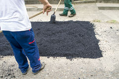 Workers pave roads Stock Photo