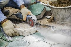 Workers is paving brick floors. stock photo