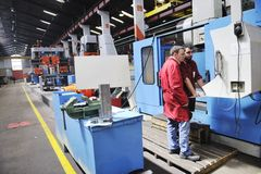Workers people in factory. Engineering people manofacturing industry with big modern computer mashines royalty free stock photo