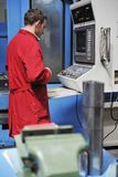 Workers people in factory. Engineering people manofacturing industry with big modern computer mashines stock photo