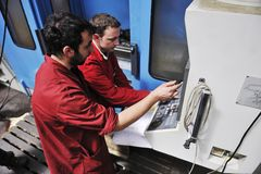 Workers people in factory. Engineering people manofacturing industry with big modern computer mashines stock images