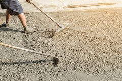 Workers person not wearing dirt boots digging with hoe & x28;shovel& x29; royalty free stock images