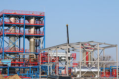 Workers on petrochemical plant construction site Royalty Free Stock Images