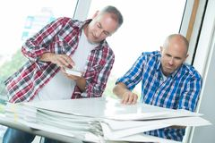 Workers with pile papers. Workers with a pile of papers Royalty Free Stock Photo
