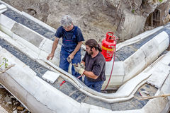 Workers are placing set of Styrofoam thermal insulation on new p Royalty Free Stock Photos