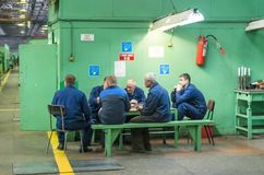 Workers of plant on a break Royalty Free Stock Photo