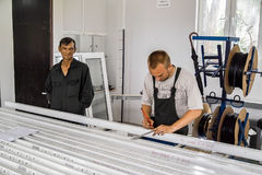 Workers at the plant for the production of plastic Windows in the Kaluga region in Russia. Royalty Free Stock Images