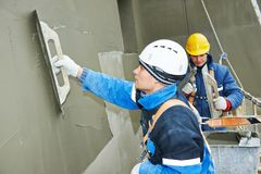 Workers at plastering facade work Stock Images