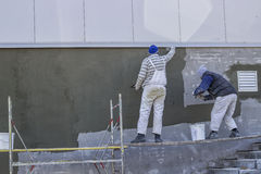 Workers plastering a outdoor wall 2 Stock Photos