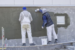 Workers plastering a outdoor wall 3 Royalty Free Stock Photo