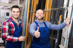 Workers posing in PVC shop Stock Images