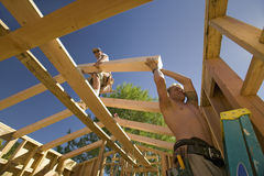 Workers position support beams Stock Images