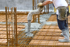 Workers pouring concrete Stock Images